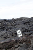 Road Closed sign surrounded by black lava Stock Photography