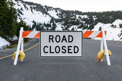 Road Closed Signpost. Due to snow Royalty Free Stock Image
