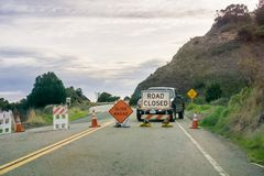 `Road closed ` and `Slide Ahead ` signs. Posted at the south side of Big Sur, Ragged Point, California stock images