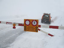Road closed to snow and avalanche danger Stock Image