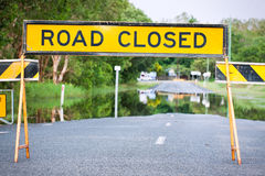 Road closed traffic sign on flooded road Royalty Free Stock Photos
