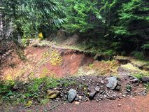 Road Closed Due To Landslide in Oregon. Road closed in the Umpqua National Forest of Oregon because of a large landslide that took out this forest service BLM Stock Photos