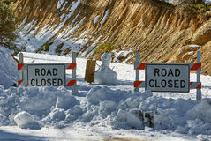 Road closed, USA. In the mountains, the roads are closed, standing snowman with a sign, USA Stock Photo
