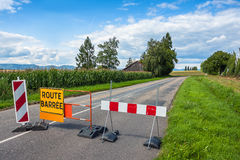 Road closed warning safety sign on French on traffic barriers on Stock Image