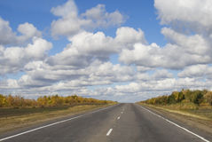 Road and cloud sky in summer day Royalty Free Stock Photo