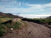 Road. In clouds Royalty Free Stock Photos