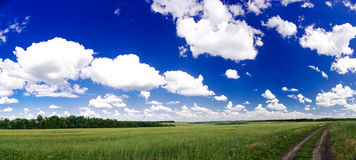 Road with clouds. Panoramic summer landscape, clouds, nature Stock Photography