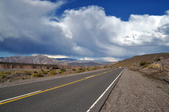 Road and clouds in the Andes mountains Stock Image