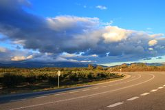 Spanish road and clouds in Countryside, Catalunia. Road and clouds in Countryside, Catalunia in the northern of Spain stock photography