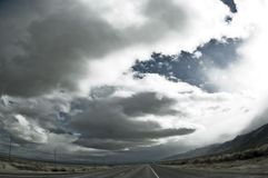 Road clouds and desert. Wide angle. Royalty Free Stock Photos