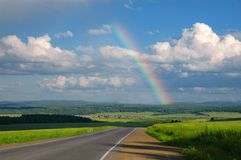 Road, clouds and rainbow Royalty Free Stock Photos