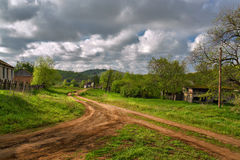 Road, clouds, village. Russian steppe. Stock Photo