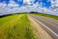 On the road with clouds Royalty Free Stock Image