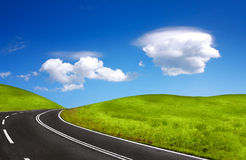 Road and cloudy sky royalty free stock photos