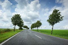 Road with cloudy sky Royalty Free Stock Photography