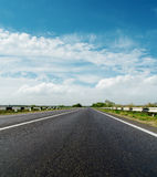 Road and cloudy sky Stock Photography