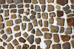 Road from cobble-stones. The foot road made of small stones. the winter, between stones is snow Stock Photo
