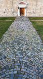 Road cobbled by  stone blocks Royalty Free Stock Photo