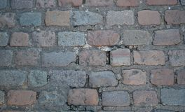 Road cobbles in grey and light reds. Old Road cobbles in grey and light reds traditional and aged Stock Photos