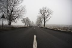 Road on a cold foggy winter's day Royalty Free Stock Photos