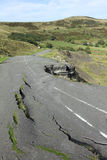 Road Collapse. (A625) in Derbyshire Peak District, England due to erosion Closed to through traffic in 1979 after continued failed attempts at reparation royalty free stock image