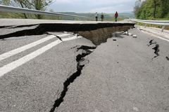 Road collapses with huge cracks. International road collapsed down after bad construction. Damaged Highway Road. Asphalt road. royalty free stock images