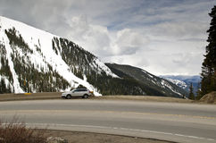 Road in Colorado with snowy mountains Royalty Free Stock Photography