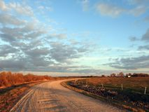 Road and colorful cloudy sky, Lithuania royalty free stock photo