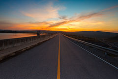 The road and colorful sunset Stock Photo