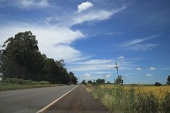 Road and colors: yelow, grey, green, white and blue in Brazil. royalty free stock photography