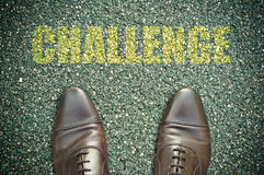 Road concept - challenge. Concept message on the road with feet - challenge Stock Photography