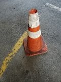 Road cone. Road construction cone on pavement Royalty Free Stock Photography