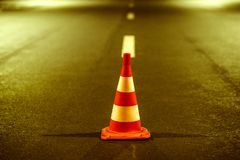 Road marking and orange cone in parking on the asphalt Stock Image