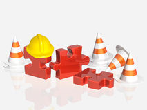 Road cones, part of puzzle and hat Royalty Free Stock Photography