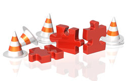 Road cones and part of puzzle Royalty Free Stock Photo