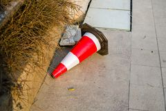 Road cone bucket. The road conical barrel collapsed in the road stock image