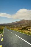 Road on Connemara mountains. Connemara is a district in the west of Ireland of which the boundaries are not well defined. Some define it to be the land contained Royalty Free Stock Photography