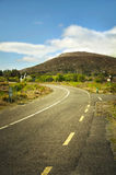 Road on Connemara mountains. Connemara is a district in the west of Ireland of which the boundaries are not well defined. Some define it to be the land contained Royalty Free Stock Images
