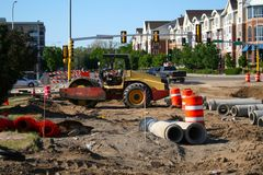 Road construction. Project near new townhouse development. Economic stimulus at work Stock Photo