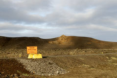 Road construction. A sign in rural Iceland indicating the construction of a new road Stock Photography