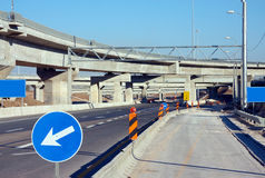 Road construction. View of a road and a bridge under construction with traffic signs royalty free stock image