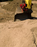 Road construction. A road construction site with a bulldozer and sand everywhere Stock Photos