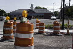 Road Construction. Orange barrels for road construction in front of a business parking lot Royalty Free Stock Photo