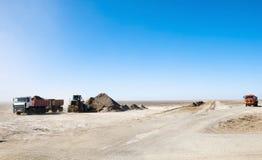 Road construction. In desert, trucks and excavators in work Stock Images