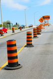 Road construction. Signs and cones on city street Stock Image
