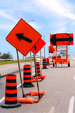 Road construction. Signs and cones on a city street Stock Photography