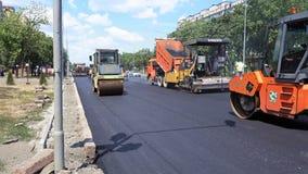 Road construction. Applying new hot asphalt. Royalty Free Stock Photo