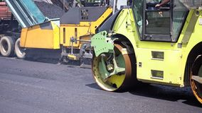 Road construction. Applying new hot asphalt. Road construction. Applying new hot asphalt using road construction machinery and power industrial tools. Roadworks Stock Photography