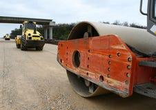 Road Construction. An asphalt roller prepares an asphalt road Stock Images