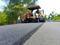 Road construction. Asphalt road construction in Thailand, blurred images royalty free stock photos